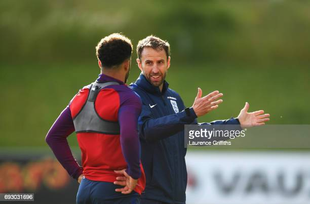 Gareth Southgate manager of England in discussion with Kyle Walker during a training session as part of England media access at St George's Park on...