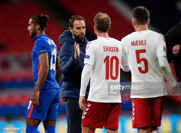 Gareth Southgate Manager of England interacts with Christian Eriksen of Denmark after the UEFA Nations League group stage match between England and...