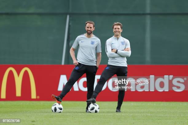 Gareth Southgate Manager of England looks on during a training session as part of the England media access at Spartak Zelenogorsk Stadium ahead of...