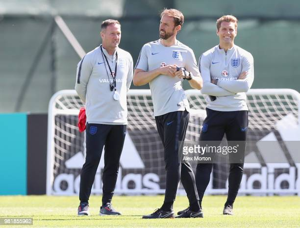 Gareth Southgate Manager of England looks on during the England Training session with his coaching staff Steve Holland and Allan Russell on June 23...