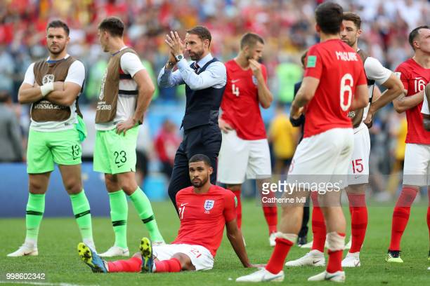 Gareth Southgate Manager of England Ruben LoftusCheek and Harry Maguire of England look dejected following his team's defeat in the 2018 FIFA World...