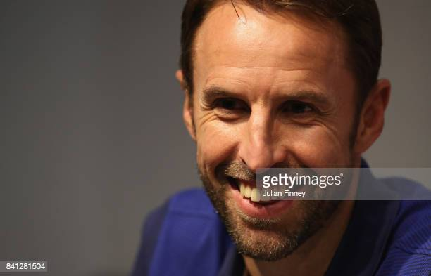 Gareth Southgate manager of England smiles during an England press conference on the eve of the World Cup qualifying match against Malta at Ta'Qali...