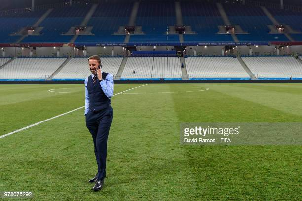 Gareth Southgate Manager of England speaks on his phone on the pitch at the end of the 2018 FIFA World Cup Russia group G match between Tunisia and...