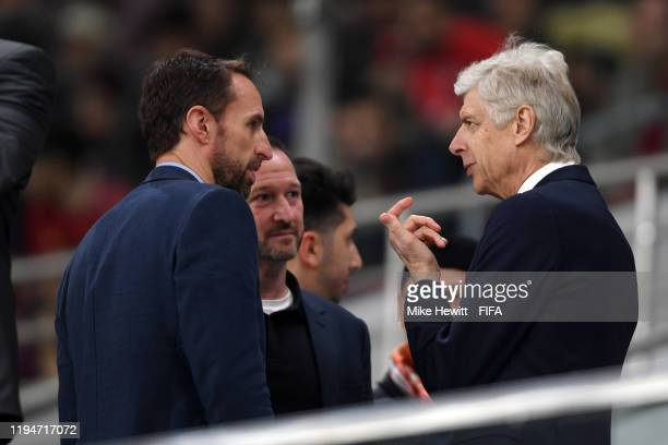 Gareth Southgate Manager of England speaks to Arsene Wenger Head of Global Football Development at FIFA during the FIFA Club World Cup semifinal...