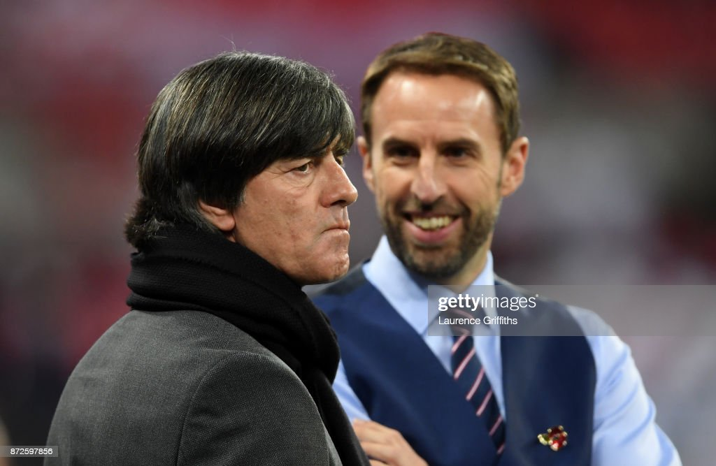 Gareth Southgate, Manager of England speaks to Joachim Loew, coach of Germany prior to the International friendly match between England and Germany at Wembley Stadium on November 10, 2017 in London, England.