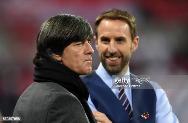 Gareth Southgate Manager of England speaks to Joachim Loew coach of Germany prior to the International friendly match between England and Germany at...