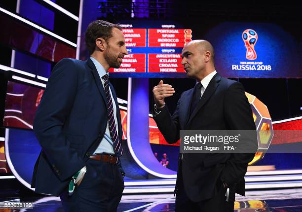 Gareth Southgate Manager of England speaks to Roberto Martinez Manager of Belgium during the Final Draw for the 2018 FIFA World Cup Russia at the...