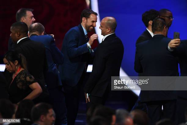 Gareth Southgate Manager of England speaks to Roberto Martinez Manager of Belgium after the Final Draw for the 2018 FIFA World Cup Russia at the...