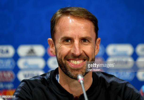 England manager Gareth Southgate is seen on a tv screen at the mixed zone area during the England press conference ahead of the 2018 FIFA World Cup...