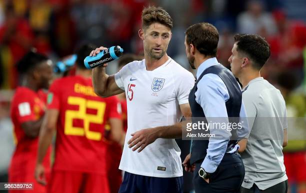 Gareth Southgate, Manager of England speaks with Gary Cahill of England during the 2018 FIFA World Cup Russia group G match between England and...