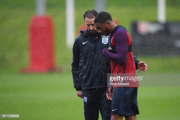 Gareth Southgate manager of England speaks with Joseph Gomez of England during an England training session at St Georges Park on November 7 2017 in...