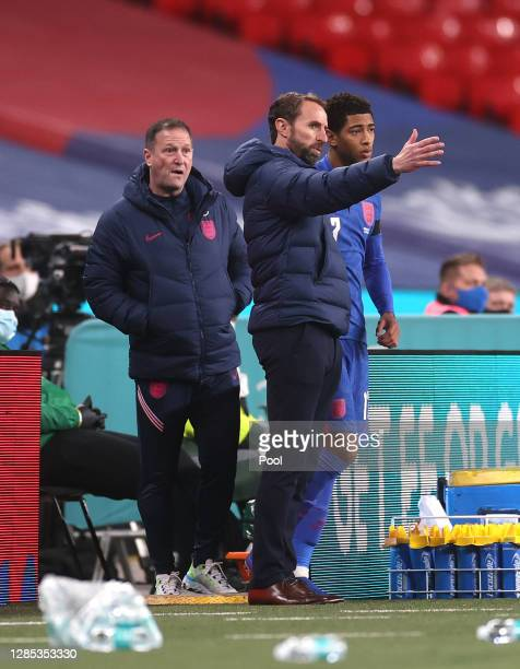 Gareth Southgate, Manager of England speaks with Jude Bellingham of England during the international friendly match between England and the Republic...