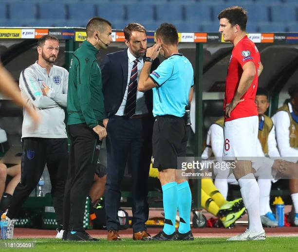 Gareth Southgate Manager of England speaks with referee Vasil Levski during the UEFA Euro 2020 qualifier between Bulgaria and England on October 14...
