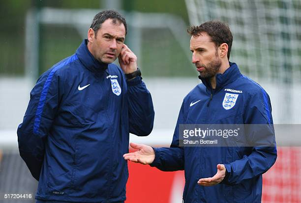 Gareth Southgate manager of England U21 and coach Paul Clement in discussion during an England U21 training session ahead of their UEFA U21 European...