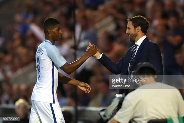 Gareth Southgate, Manager of England U-21 shakes hands with Marcus Rashford of England as he is substituted during the European Under 21 Qualifier...