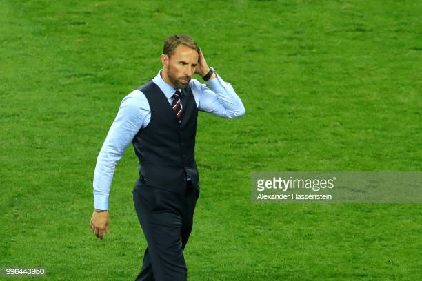 Gareth Southgate Manager of England walks off the pitch dejected following the 2018 FIFA World Cup Russia Semi Final match between England and...