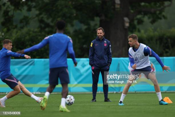 Gareth Southgate, Manager of England watches on as Kieran Trippier and Jordan Henderson of England take part in the England Training Session at...