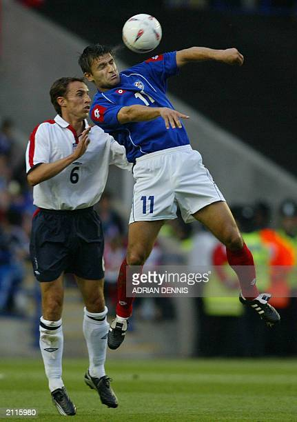 Gareth Southgate of England closes in on Nenad Jestrovic of Serbia and Montgenegro during the international friendly match at The Walkers Stadium in...