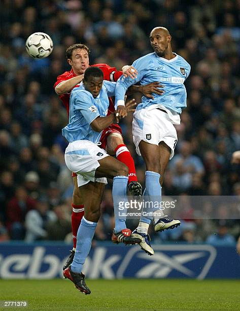 Gareth Southgate of Middlesbrough Shaun Wright Phillips and Nicolas Anelka of Manchester City all jump for the ball during the FA Barclaycard...