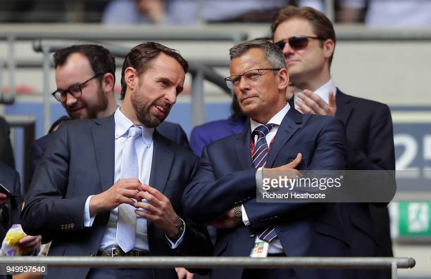 Gareth Southgate speaks to FA chief executive Martin Glenn during the The Emirates FA Cup Semi Final match between Chelsea and Southampton at Wembley...