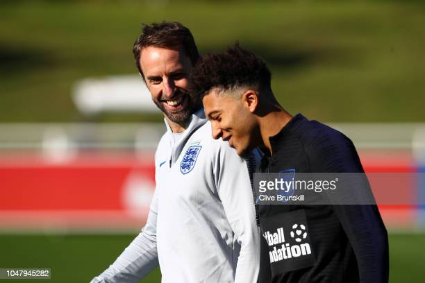 Gareth Southgate speaks to Jadon Sancho during an England Training Session at St Georges Park on October 9 2018 in BurtonuponTrent England