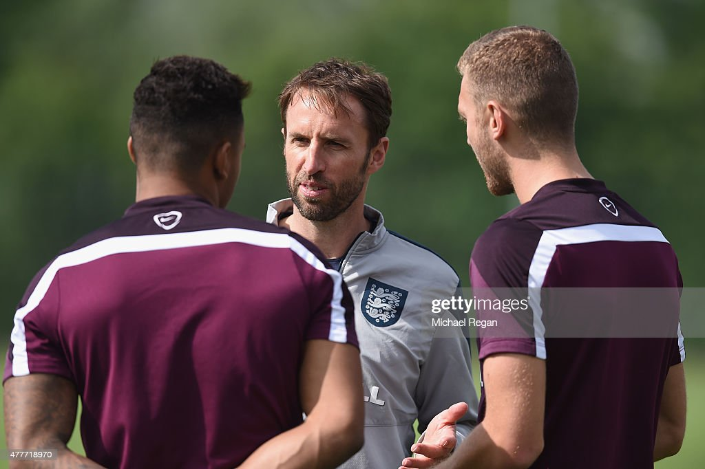 Gareth Southgate speaks to Liam Moore and Ben Gibson during the England U21 training session and press conference on June 19, 2015 in Olomouc, Czech Republic.