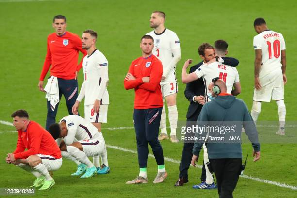 Gareth Southgate the head coach / manager of England consoles Declan Rice of England during the UEFA Euro 2020 Championship Final between Italy and...