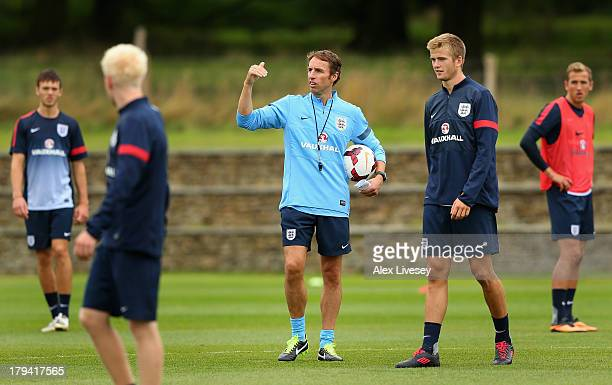Gareth Southgate the manager of the England Under-21 team gives instructions to his players during a training session at St Georges Park on September...