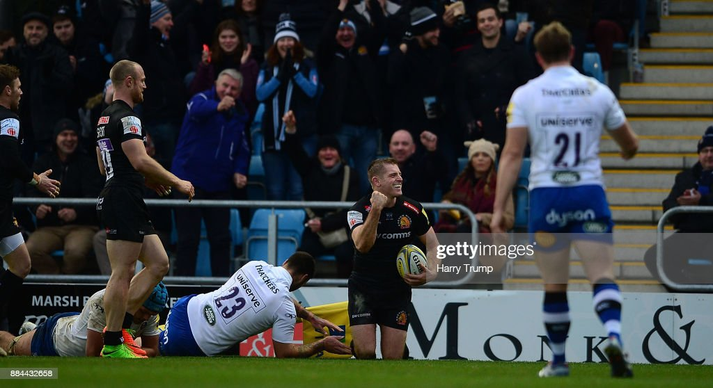 Gareth Steenson of Exeter Chiefs(C) celebrates after scoring a try during the Aviva Premiership match between Exeter Chiefs and Bath Rugby at Sandy Park on December 2, 2017 in Exeter, England.