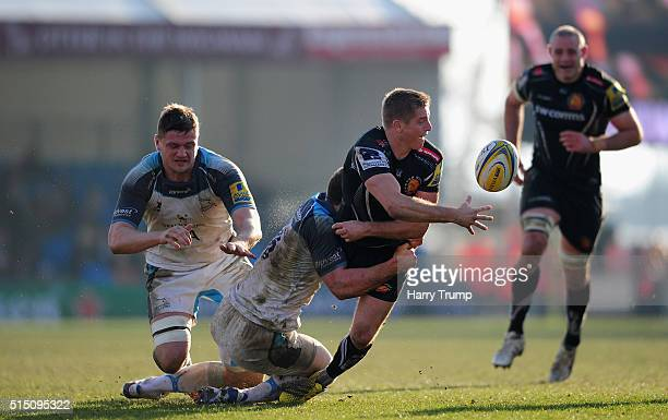 Gareth Steenson of Exeter Chiefs is tackled by Mark Wilson of Newcastle Falcons during the Aviva Premiership match between Exeter Chiefs and...