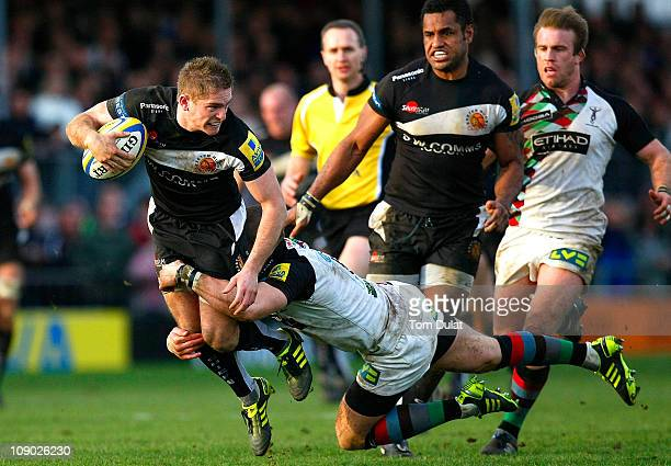 Gareth Steenson of Exeter Chiefs is tackled by Mike Brown of Harlequins during the Aviva Premiership match between Exeter Chiefs and Harlequins at...