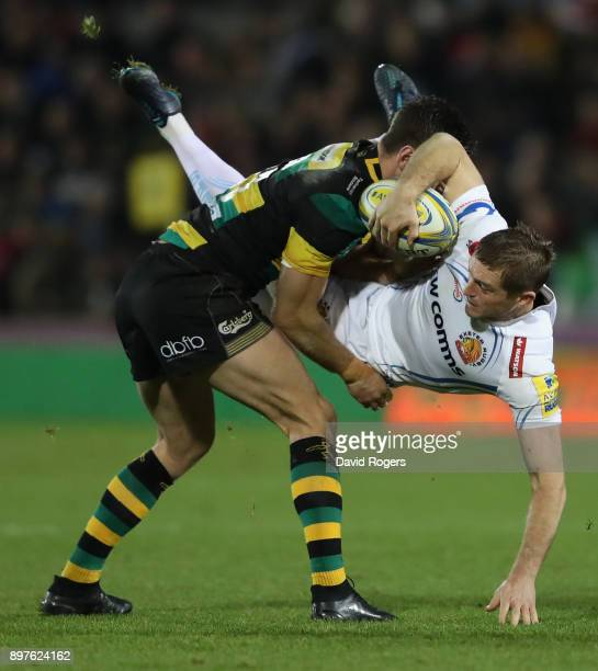 Gareth Steenson of Exeter Chiefs is tackled by Rob Horne during the Aviva Premiership match between Northampton Saints and Exeter Chiefs at...