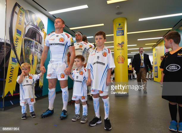 Gareth Steenson of Exeter Chiefs prepares to walk out with his children prior to the Aviva Premiership Final between Wasps and Exeter Chiefs at...