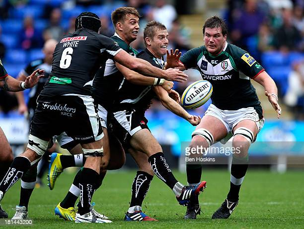 Gareth Steenson of Exeter passes the ball under pressure from Alex Lewington of London Irish during the Aviva Premiership match between London Irish...