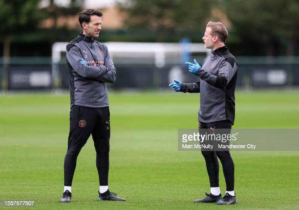 Gareth Taylor and Alan Mahon of Manchester City in action during a training session at Manchester City Football Academy on July 17 2020 in Manchester...