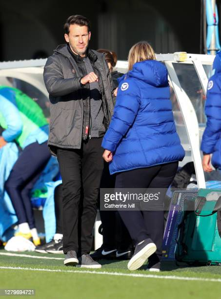 Gareth Taylor manager of Manchester City and Emma Hayes manager of Chelsea fist bump after the Barclays FA Women's Super League match between Chelsea...
