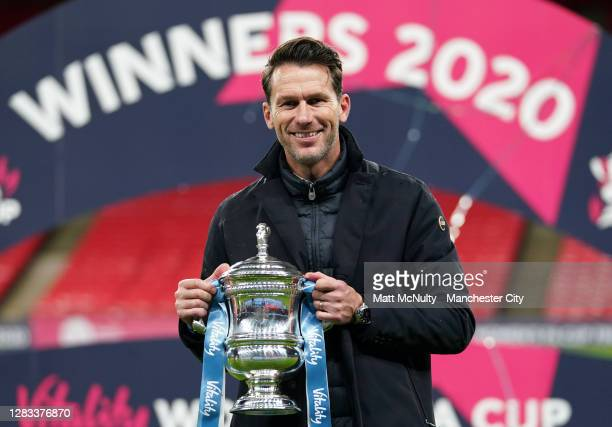 Gareth Taylor, manager of Manchester City celebrates with the trophy during the Vitality Women's FA Cup Final match between Everton Women and...