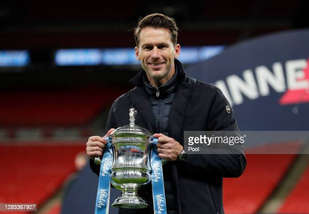 Gareth Taylor, Manager of Manchester City celebrates with the Vitality Women's FA Cup Trophy following his team's victory in the Vitality Women's FA...