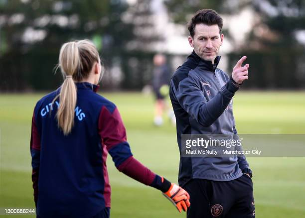 Gareth Taylor, manager of Manchester City talks with Ellie Roebuck during a training session at Manchester City Football Academy on February 05, 2021...