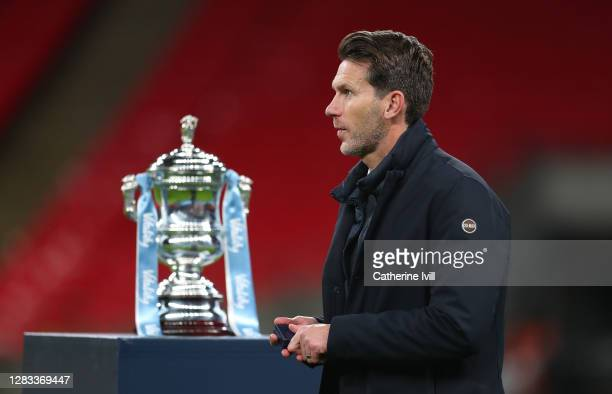 Gareth Taylor, Manager of Manchester City walks past the Vitality Women's FA Cup Trophy following his team's victory in the Vitality Women's FA Cup...