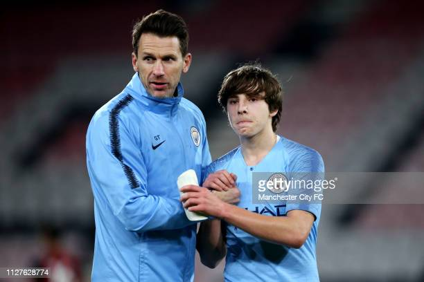 Gareth Taylor of Manchester City and and Adrian Bernabe celebrate victory after the FA Youth Cup 6th Round match between AFC Bournemouth and...