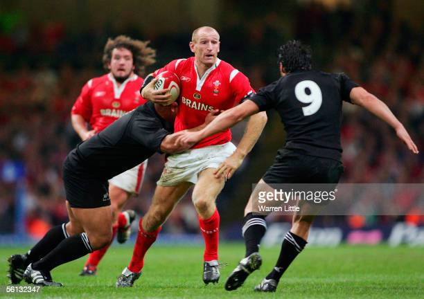 Gareth Thomas of Wales is wrapped up by the New Zealand defence during The Invesco Perpetual Series 2005 between Wales and New Zealand at the...