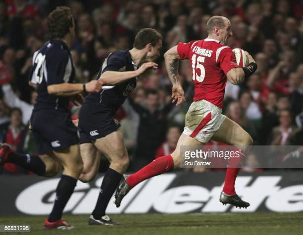 Gareth Thomas of Wales races through the Scottish defence to score a try during the RBS Six Nations Championship Match between Wales and Scotland on...