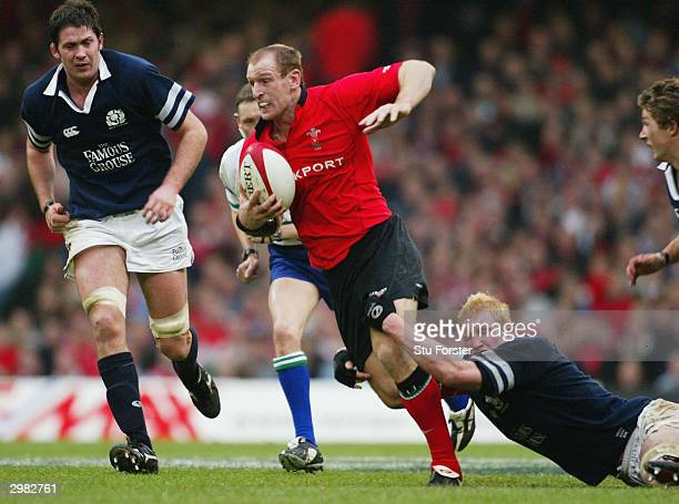 Gareth Thomas of Wales takes on the Scotland defence during the RBS 2004 Six Nations match between Wales and Scotland at The Millennium Stadium on...