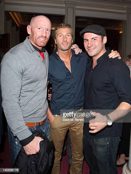 Gareth Thomas Robbie Savage and Joe Calzage appear during media night for Russell Grant in the role of the Wizard in 'The Wizard of Oz' at the London...
