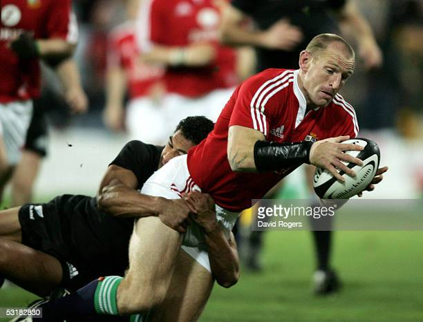 Gareth Thomas the Lions captain dives over to score the first try during the second test match between The New Zealand All Blacks and the British and...