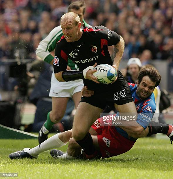 Gareth Thomas the Toulouse wing is tackled by Christophe Dominici during the Heineken Cup Final between Stade Francais and Toulouse at Murrayfield on...