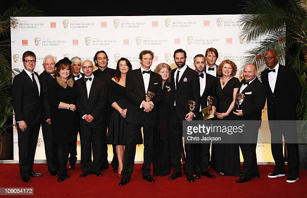 Gareth Unwin Emile Sherman Colin Firth Tom Hooper and Iain Canning and the cast and crew pose with the award for Best Film for the film The King's...