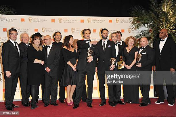 Gareth Unwin Emile Sherman Colin Firth Tom Hooper Iain Canning and the cast and crew pose with the award for Best Film for the film 'The King's...