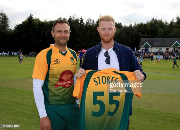 Gareth White captain of Cockermouth Cricket Club presents England's Ben Stokes with a club shirt during the PCA England Masters Day at Cockermouth...